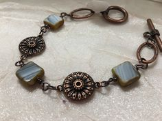 A personal favorite from my Etsy shop https://www.etsy.com/listing/257449281/bronze-link-bracelet-beaded-bronze