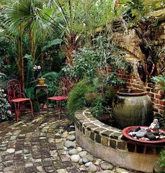 Charleston Courtyard Courtyards are ideal outdoor living spaces, providing seclusion in an otherwise open backyard. As opposed to the more social front porch or open gazebo, they provide the perfect place to withdraw from the world. Lush tropical foliage brings new life to this courtyard & provides additional privacy. Buried bricks were recovered to add to the walls and patio, lending a sense of antiquity to the space. River stones around the base of the fountain reinforce a water theme.