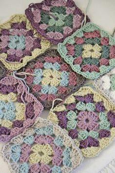 crochet ... luv the colors in these grannie squares ...