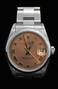Une montre Rolex modèle Oyster Datejust en acier sur un bracelet Oyster à boucle déployante en acier.   Cadran rose, chiffres romains, date à 3 heures.  Mouvement automatique.  Diamètre: 30 mm.  Année 2003.