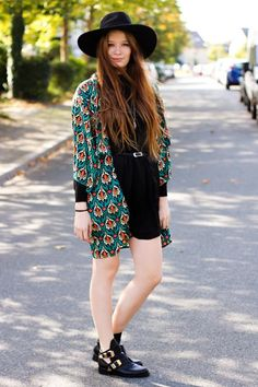 Street Style: 26 Ways to Style a Kimono for Spring - bright printed kimono styled with a wide-brim hat + mini LBD and buckled flat booties.