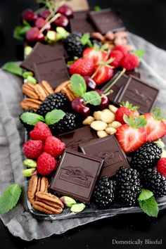 This Gourmet Chocolate Dessert Board is a decadent treat with an array of Ghirardelli Intense Dark chocolate, fresh fruits, and nuts. Charcuterie Recipes, Charcuterie And Cheese Board, Cheese Boards, Meat Cheese Platters, Appetizer Recipes, Dessert Recipes, Dessert Food, Gourmet Desserts, Plated Desserts