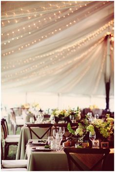 I love the christmas lights in bewteen the fabric of the tent! #weddings