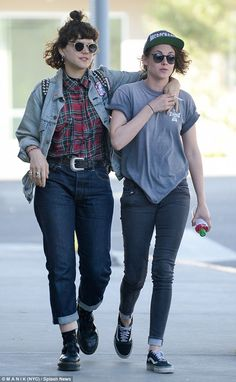 Girls' day out: Kristen Stewart was pictured walking down the street arm-in-arm with a fem...