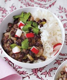 Cuban Black Beans and Rice|Transform leftovers of this hearty dish into another great meal: Simply scoop the beans and rice into large tortillas and warm in the microwave until heated through. Serve with sour cream and salsa, if desired. Try more black bean recipes: