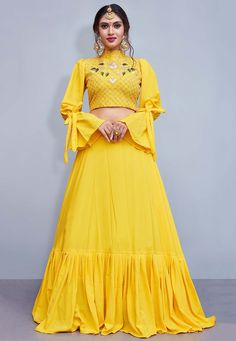 Get Beautiful Yellow Color Crepe Silk Designer Lehenga Chol latest designer party wear lehenga, wedding wear lehenga choli for women at VJV Fashions. Indian Gowns Dresses, Indian Fashion Dresses, Indian Designer Outfits, Dress Indian Style, Designer Dresses, Party Wear Lehenga, Red Lehenga, Party Wear Dresses, Yellow Lehenga