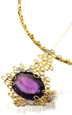 """A gold, amethyst and diamond collar necklace, by Andrew Grima, 1969 The pendant set horizontally with an oval fancy-cut amethyst, suspended in a cloud of """"smoke rings"""", with single-cut diamond accents, the rigid torque applied with further """"smoke ring"""" accents, mounted in 18 carat yellow gold, signed Grima, workshop marks HJCo, London hallmarks, length of pendant 6.5cm, fitted maker's pouch"""