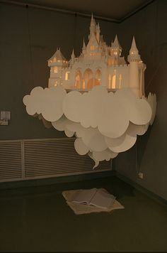 A faerie tale castle floats above a book
