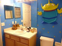 Use your favorite Disney characters, like the aliens from Toy Story, to create a lively, youthful sp Princess Bathroom, Disney Princess Bedroom, Toy Story Nursery, Toy Story Bedroom, Disney Bathroom, Bathroom Kids, Disney Rooms, Disney House, Disney Home Decor