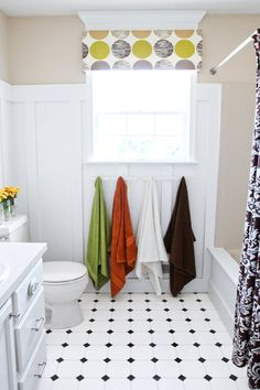 Cottage-style wainscoting, custom mirror frames, and bargain-priced fixtures turn a builder's-basic bath into something special. |   thisoldhouse.com