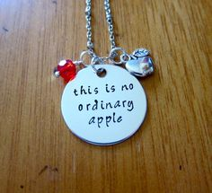"""Snow White Inspired Necklace. Poison Apple. Evil Queen Villain. """"This is no ordinary apple"""". Snow White. Silver colored. Swarovski crystal"""