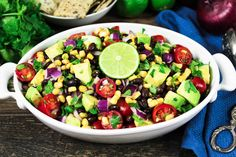 This Avocado, Black Bean & Corn Salad w/ Cilantro Lime Dressing is such a bright, colorful and flavorful dish. It looks like a fiesta on a plate