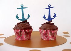 A set of 12 anchor cupcake toppers  These large cupcake toppers can be used as singles on a cupcake or several on a large cake for a definite show stopper.  Perfect for a nautical themed party or even a rockabilly wedding cake!  These measure 5.7 x 7cms (2.2 x 2.7inches) and are made from low shed, high quality glitter cardstock and secured to food grade wooden skewers.  They are available in either single sided (white on reverse) or double sided glitter. If choosing double sided, the skewer…