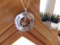 a simple round washer with star charm and crystal hanging in the centre