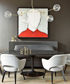 In this Manhattan apartment, Shamir Shah hung a chandelier by Lindsey Adelman above an Eero Saarinen table and chairs.