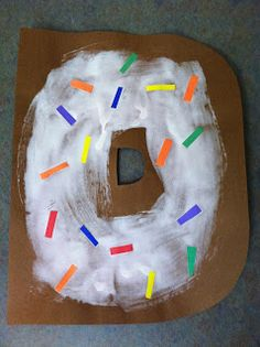 "D is for Donut storytime: read ""If you give a dog a donut"" and did the ""down around the corner..."" game!"