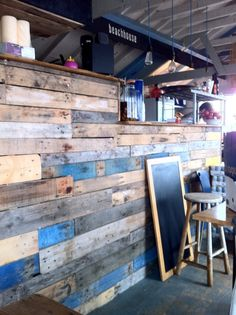 love the distressed wood paneling on the wall (at the Beach Shack)