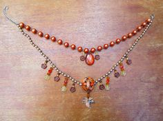 Orange, Brown, and Amber Tone Necklace with Vintage Pendant. $19.00, via Etsy.