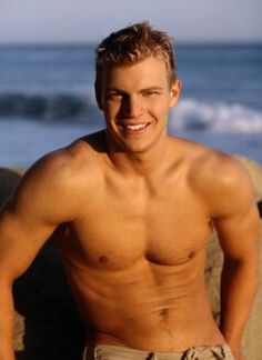 Young hunky shirtless blonde at the beach