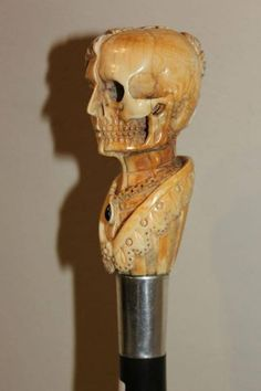 Walking cane circa 1900. Half woman half skull carved in ivory.