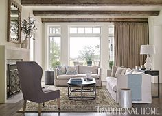 Elegant pieces of furniture borrow their interest from shapely silhouettes and highly textural fabrics in the living room. - Photo: Emily Jenkins Followill / Design: Beth Webb