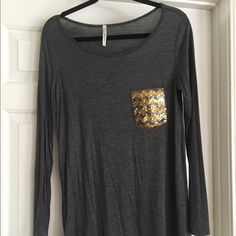 Super cute Boutique Top with sequin pocket. Like new, rayon/spandex. Size is small but these run a little big. Somewhat sheer material but not see through! I wore a cami underneath 😍😍 Tops