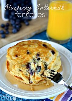 Delicious Blueberry Buttermilk Pancakes are the perfect breakfast any day of the week! | MomOnTimeout.com | #breakfast #brunch
