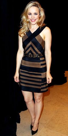 At the Toronto Film Festival, McAdams attended a press event in a belted black and brown minidress and pointy-toe pumps.