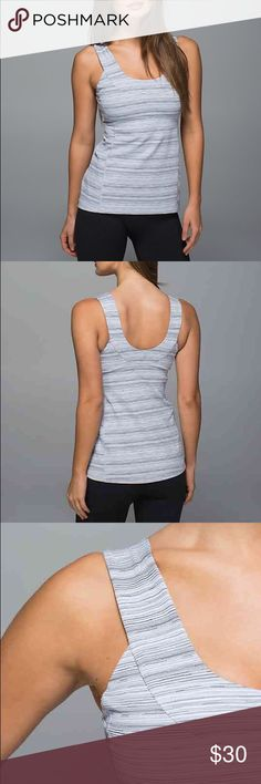 New Lululemon scoop neck tank top silver 12 Lululemon athletica scoop neck tank. Size 12. It's hard to perfect our Downward Dog when our top is riding up—so we gave this open-necked tank a tight fit that helps it stay put when we move. The cottony-soft fabric feels great against our skin. Color is cyber silver fox.  sweat-wicking Luon® fabric is four-way stretch, naturally breathable and engineered for serious stretch and recovery added LYCRA® fibre bends with you and stays in great shape…