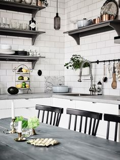 Created from dozens of interesting and personal looking decor details, this Scandinavian style home apartment in Sweden charms with a cozy and comfortable atmosphere. Dominating white and grey tones get spicy texture from leather and wooden furniture, while the decor elements on the walls and the lighting fixtures give the final touch for the interiors. This beautiful apartment is listed at Entrance.  The ultimate heart of this home is the warmly welcoming kitchen with open shelves, pendant…
