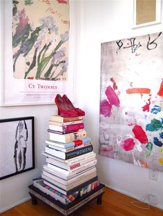 "Juxtapose ""it"" or ""them""....i have jimmy choos & dr. martins to place here with art books i <3& art...that moves me..."