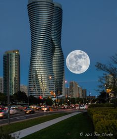 A composite photo of the Super Moon + Absolute condos in Mississauga = Stunning!