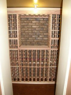 We recently converted an outdated basement room into a beautiful wine cellar for a client. What made the wine cellar really special was the faux stone paneling on the back wall which added instant character to the space. Faux brick has benefited immensely from advances in technology and today's faux brink is realistic, lightweight, inexpensive and easy to install.
