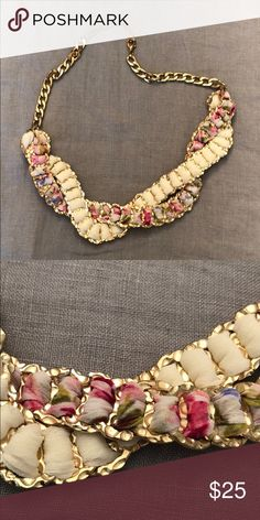 69e55ff9325 NWOT Statement Necklace Gold statement necklace interwoven with pink and  white floral fabric. Beautiful and