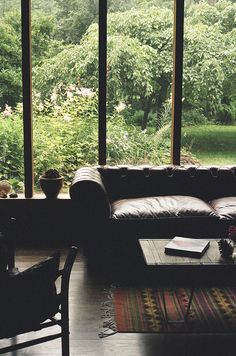 Leather sofa, kilim, perfect lush green garden, big windows