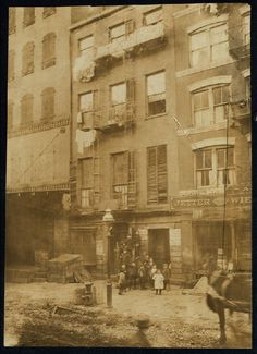Tenement house with children in front. Possibly 36 Laight St. Location: New York, New York (State).