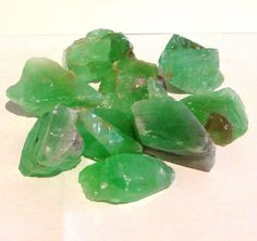 Green Calcite.  A mental healer which helps dissolve rigid beliefs and old programs. Restores balance to the mind. Helps in letting go of what is familiar, but which no longer serves.  Aids in the communication and the transition from a stagnant to a positive situation.  Great for the immune system. Helps to ameliorate arthritis.        www.sacredstonegallery.com