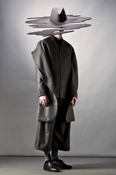 'Mareunrols' - Designers Rolands Pēterkops and Mārīte Mastiņa–Pēterkopa of the duo «Mareunrol's» have gone to Paris to show their 2014/15. autumn–winter collection «Tenant / Fieldwork Nº2» at the Men's Fashion Week.