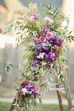 Flower-bedecked ladder | Photo by Happy Confetti Photography | Floral design by Va Va Bloom
