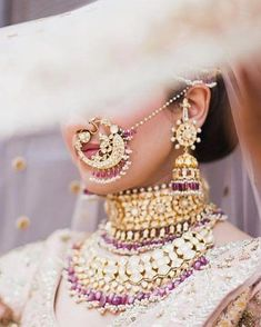 Perfect finishing to a bridal look is given by stunning nose rings! Book the best makeup artist now with BookEventZ to get the perfect bridal look on THE DAY! Indian Jewelry Sets, Indian Wedding Jewelry, Bridal Jewelry, Indian Bridal Outfits, Indian Bridal Fashion, Bridal Nose Ring, Nath Bridal, Bridal Photoshoot, Bridal Poses