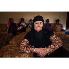 """Sara is a Bedouin woman from Wadi Musa, Jordan. """"I was born in a tent. Back then we were nomads in the desert. We grew up in hard conditions, but we were happy. We were carrying heavy buckets of water every day for many, many kilometres. We didn't buy anything.  In the 80's our community decided to move to modern homes. Life is much more comfortable here. We have shops, houses, water, furniture, electricity, TV, everything. Now when a baby is born, the mother goes to the hospital. Back then…"""