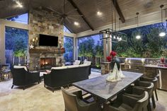 Outdoor fireplace as central focus in patio cover Houston