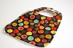 Chenille baby bib in a multi color floral print