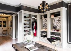 A walk in closet that has modern touches and book shelves
