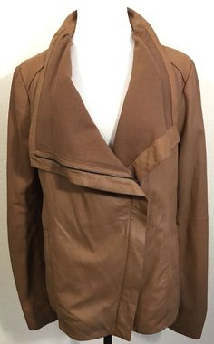 "Fabric: 100% Lamb Leather. Color / Wash: Brown. Length: 26"" Front, 24"" Back - from collar fold to bottom hem. Sleeve: 26"". Shoulder: 17"" Across. 
