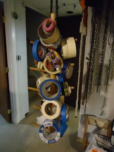 The functional tape tree. Just a big dowel with pegs in it.