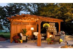 This gazebo looks so cozy with the fireplace and lamp and globe lights