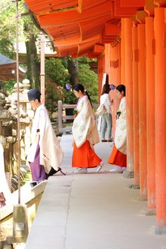 Procession of priests and attendants exiting a Shinto shrine.