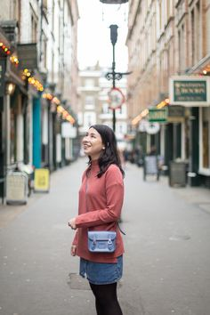 Our Sales Advisor Amy wears our Tiny Satchel in Dusk Blue.