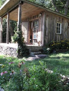 "I want a miniature cabin with porch like this up in our woods at the ranch...for ""camping"" with the boys.  :)"